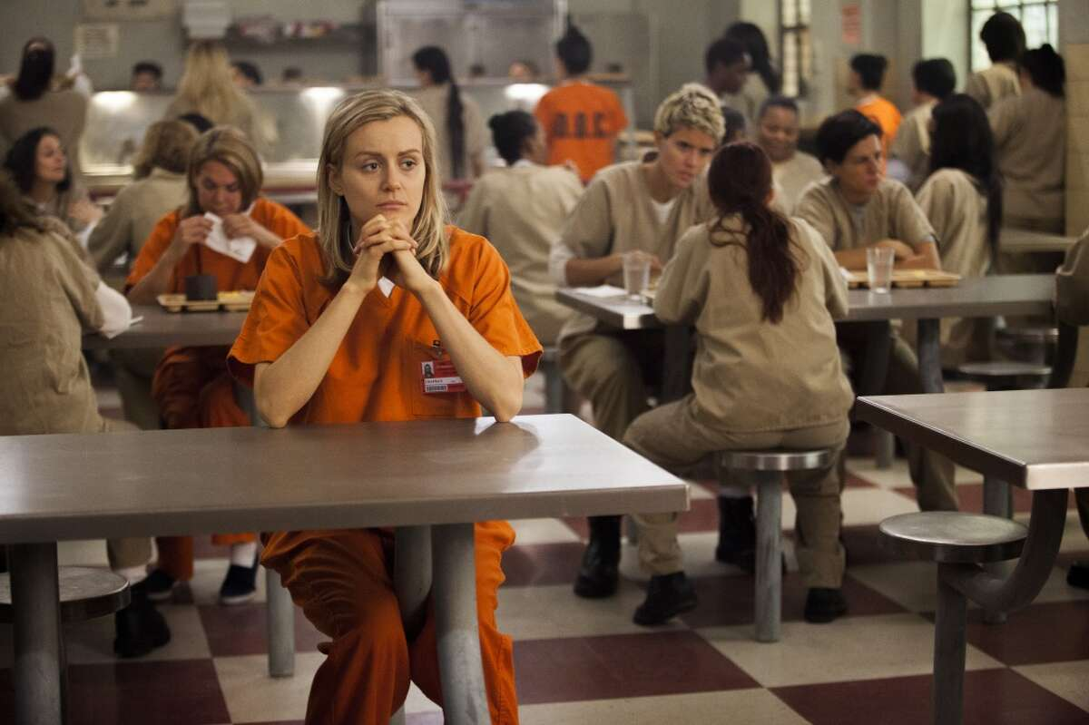 Taylor Schilling stars in ''Orange is the New Black'' as Piper Chapman, a bisexual, bougie-type woman who goes to prison on an old drug-running charge. It's based on the memoir of the same name, by author Piper Kerman. (The book has the subtitle: ''My Year in a Women's Prison'').