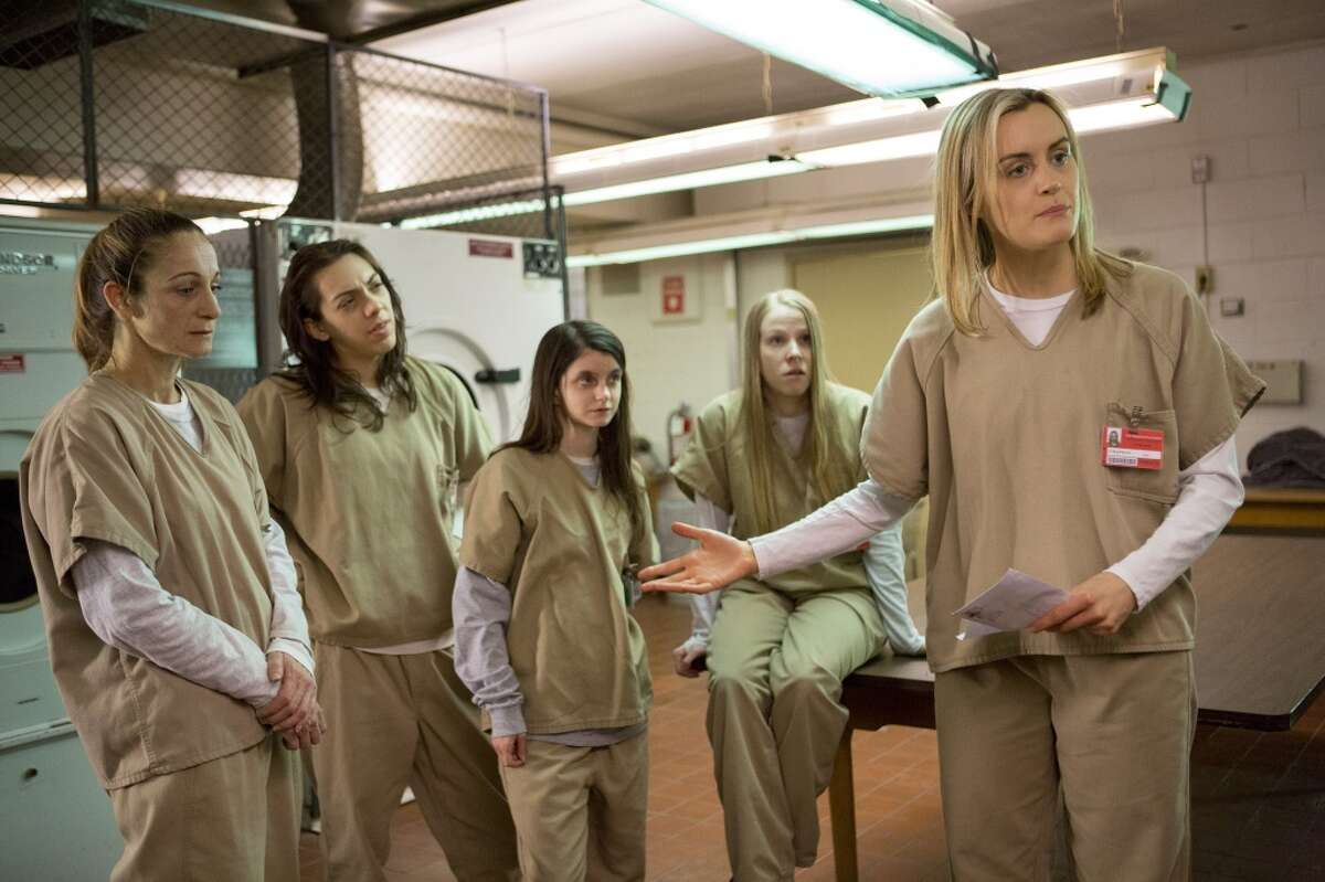 The actors in ''Orange is the New Black'' spend a lot of time wearing different versions of this outfit. Taylor Schilling is pictured, right.