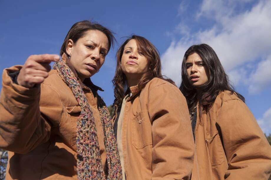 "Selenis Leyva, left, Elizabeth Rodriguez, center, and Diane Guerrero, right, looking tough in ''""Orange.'' Photo: Eric Leibowitz For Netflix"
