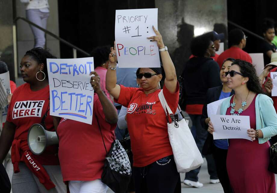 Protesters march outside the Theodore Levin United States Courthouse in Detroit. A federal judge  on Wednesday stopped any lawsuits challenging the city's bankruptcy. Photo: Paul Sancya / Associated Press