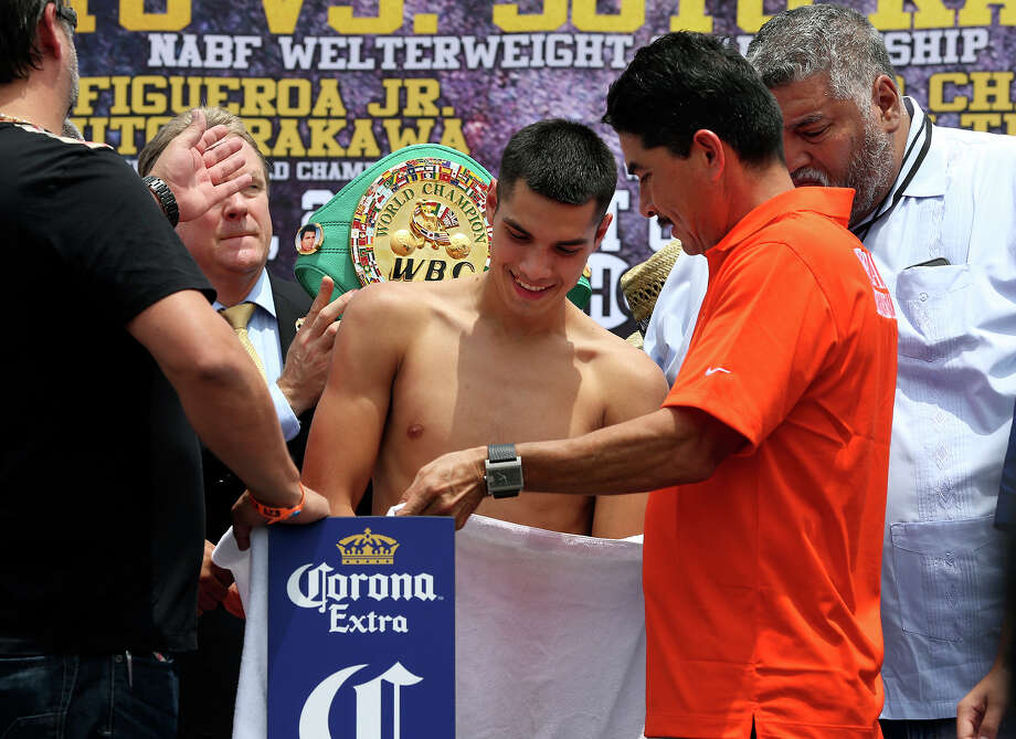 Omar Figueroa, Jr.  has to strip down naked to make the weight during the Knockout Kings II fight card weigh-in at the H.E.B. parking lot at 6818 South Zarzamora  on July 26, 2013. Photo: Tom Reel, San Antonio Express-News