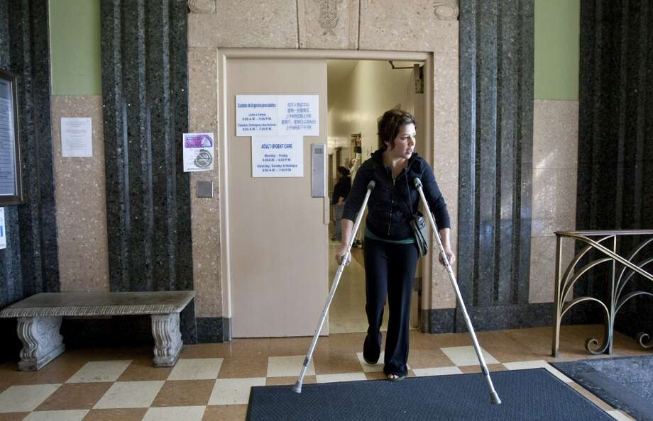 Elana Salzman, a member of the Healthy San Francisco Program, walks through San Francisco General Hospital on her way to get an x-ray for a foot injury in San Francisco on March 22, 2010.  Salzman came to the hospital's urgent care clinic. Photo: Laura Morton, Special To The Chronicle