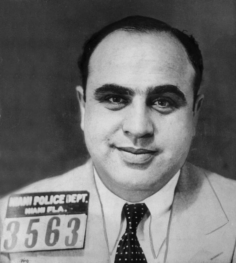 American gangster Al Capone (1899 - 1947) smiling in a jacket and tie, Miami, Florida, 1925. Photo: Hulton Archive, Getty Images / Archive Photos
