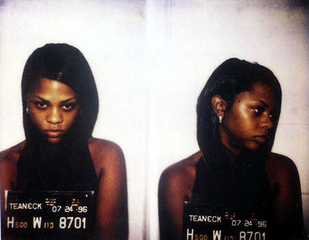 Lil Kim's 1996 Teaneck, New Jersey booking photo. Photo: Michael Ochs Archives / Michael Ochs Archives