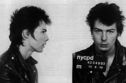 "Bassist Sid Vicious of the rock band ""The Sex Pistols"" poses for his mugshot after being arrested by New York City police for allegedly murdering his girlfriend Nancy Spungen on December 8, 1978 in New York City. Photo: Michael Ochs Archives / Michael Ochs Archives"
