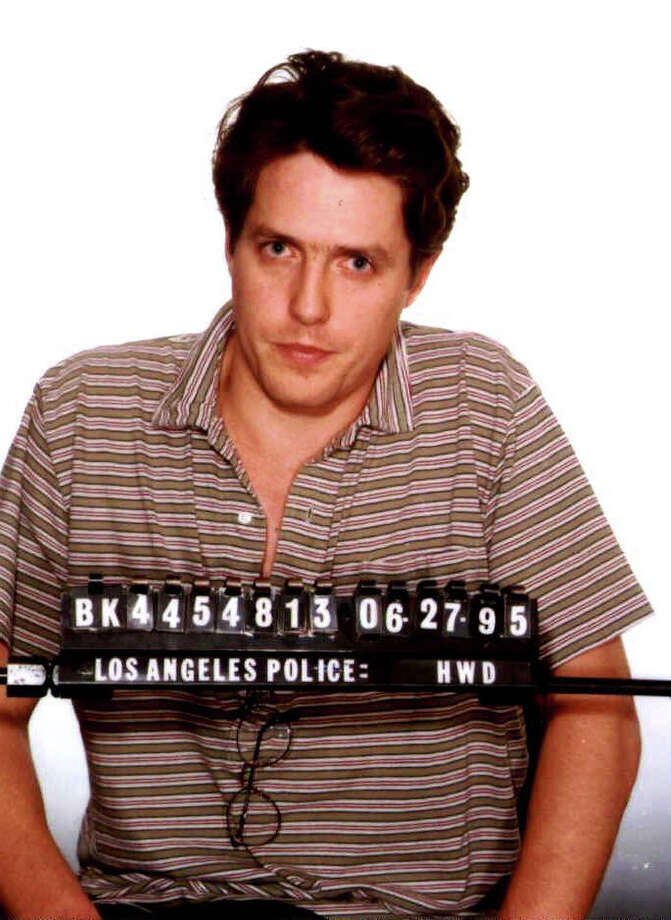 The Los Angeles Police Department booking of actor Hugh Grant in this file photo dated June 27, 1995. Grant was arrested for soliciting sex from 25-year-old prostitute Divine Brown on Sunset Boulevard. Photo: Getty Images / Getty Images North America