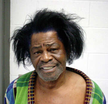 This mug shot provided by the  Aiken County Sheriff's Office shows singer James Brown, who was arrested January 28, 2004 and charged with Criminal Domestic Violence. Photo: Getty Images / 2004 Aiken County Sheriff?s Office