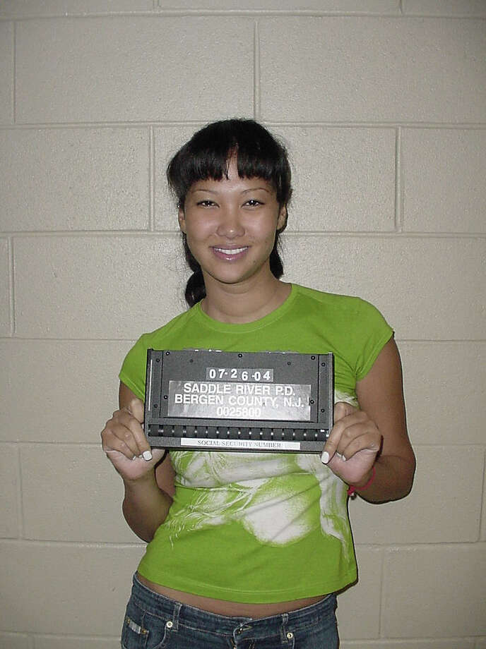 Kimora Lee Simmons, wife of hip-hop mogul Russell Simmons, is seen in this police mug shot July 26, 2004 in Saddle River, New Jersey.  Simmons was arrested and charged with eluding an officer, possessing marijuana, careless driving and operating a vehicle while possessing drugs. Photo: Getty Images / 2004 Getty Images