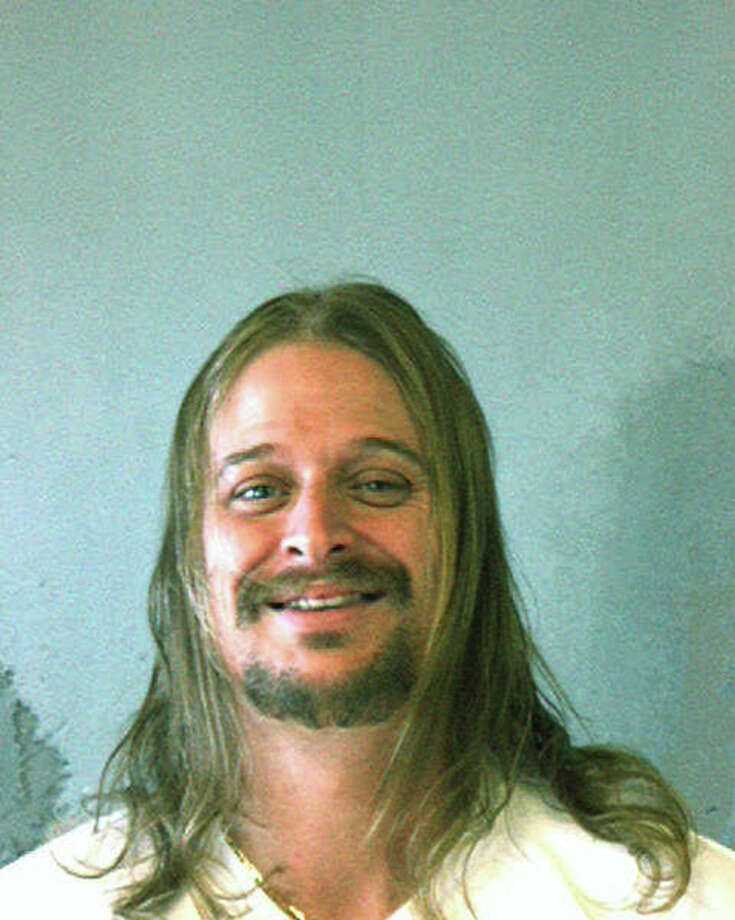 In this police mug shot from the DeKalb County Sheriff's Office, musician Kid Rock, or Robert J. Ritchie, poses for a mug shot October 21. 2007 in DeKalb County, Georgia. Kid Rock was arrested in the early morning of October 21 after a fight at a Waffle House restaurant in DeKalb County. Photo: Handout, Getty Images / 2007 DeKalb County Sheriff's Office,