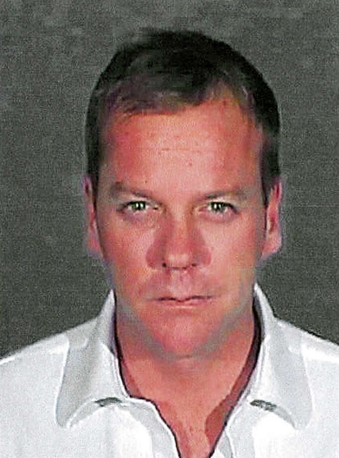In this handout photo provided by the Glendale City Police Department , actor Kiefer Sutherland poses for his mugshot photo at Glendale City Jail December 5, 2007 in Glendale City, California. Sutherland, 40,  reported to the facility to serve a 48-day sentence after pleading guilty to a second drunk driving offense. Photo: Handout, Getty Images / 2007 Glendale City Police Department