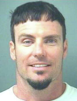 In this handout image provided by the Palm Beach County Sheriff's Office, rapper Vanilla Ice, whose real name is Robert Van Winkle, poses for his mug shot at the Palm Beach County Sheriff's Office April 10, 2008 in Palm Beach, Florida. Vanilla Ice was arrested for allegedly assaulting his wife. Photo: Handout, Getty Images / 2008 Palm Beach County Sheriff's Office