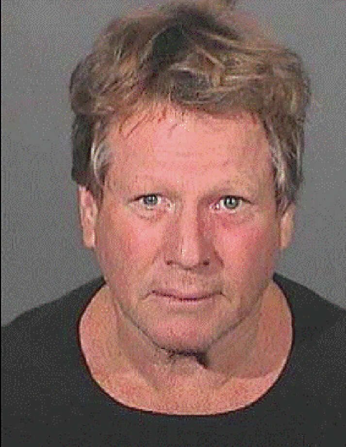 In this photo that was released by the Los Angeles County Sheriffs Department, Actor Ryan O'Neal is seen in a mugshot September 17, 2008 in Los Angeles, California. Ryan O'Neil and his son Redmond O'Neil were arrested the morning of September 17, after Los Angeles County Sheriffs Deputies and probation officers went to O'Neil's Malibu home to check on Redmond O'Neil, who is serving three-years of probation for drug possession charges, and allegedly found drugs. Photo: Handout, Getty Images / 2008 Los Angeles County Sheriffs Department