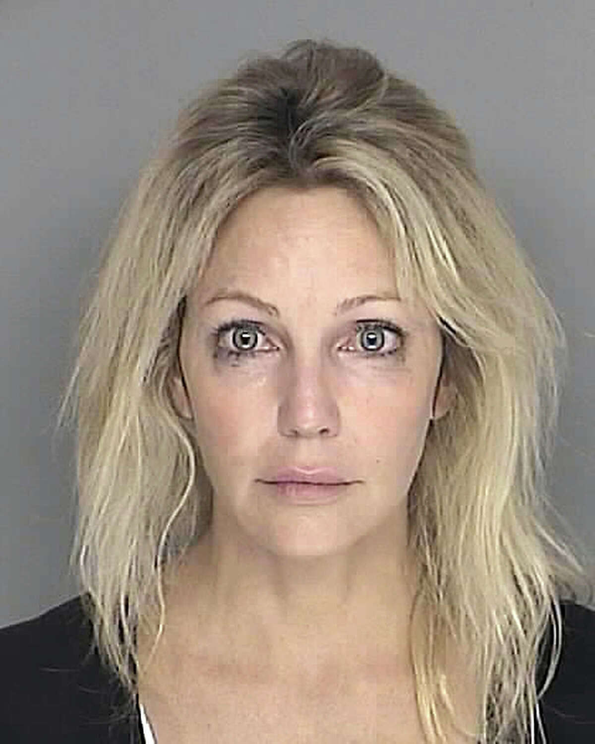 In this handout image provided by the Santa Barbara County Sheriff's Dept., actress Heather Locklear poses for a mugshot September 28, 2008 in Santa Barbara, California. Locklear was arrested on suspicion of driving under the influence of a controlled substance in the Santa Barbara area, authorities said Sunday. The case was dismissed in 2008.