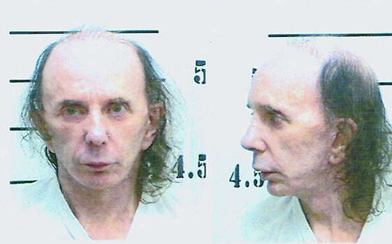 In this handout photo provided be the California Department of Corrections and Rehabilitation (CDCR), inmate Phil Spector poses for his mugshot photo on June 5, 2009 at North Kern State Prison in Delano, California.  Spector was received by the California Department of Corrections and Rehabilitation from Los Angeles County with a 19-year sentence for second-degree murder for the February 2003 shooting death of actress Lana Clarkson.  He is currently at North Kern State Prison, a reception center in Kern County.  The reception center process is used to make housing determinations. Photo: Handout, Getty Images / 2009 California Department of Corrections and Rehabilitation