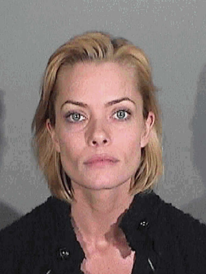 In this handout photo provided by the Santa Monica Police Department, Jaime Pressly is seen in a booking photo at the Santa Monica Police Department on January 6, 2011 in Santa Monica, California.  Pressly was arrested in Santa Monica for suspicion of driving under the influence of alcohol. Photo: Handout, Getty Images / 2010 Santa Monica Police Department