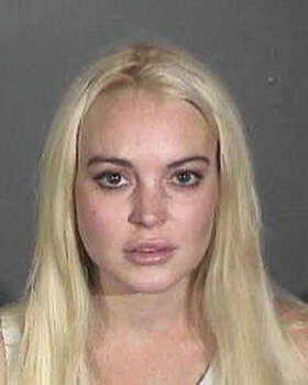 In this booking photo provided by the Los Angeles County Sheriff's Department, Lindsay Lohan is seen in a mug shot October 19, 2011 in Los Angeles, California.  Lohan was arrested for probation violations and released after posting USD 100,000 bail. Photo: Handout, Getty Images / 2011 Los Angeles County Sheriff's Department