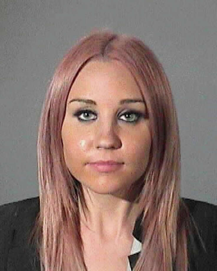 In this handout image provided by the Los Angeles County Sheriff's Office, actress Amanda Bynes is seen in a police booking photo April 6, 2012 in West Hollywood, California.  Bynes was arrested for driving under the influence of alcohol. Photo: Handout, Getty Images / 2012 Los Angeles County Sheriff's Office
