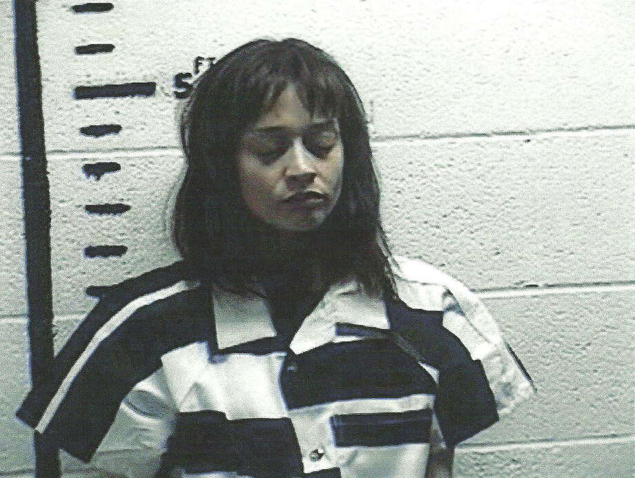 In this handout photo provided by the Hudspeth County Sherriff's Office, singer Fiona Apple is seen in a police booking photo September 19, 2012 in Sierra Blanca, Texas.  Apple was arrested for alleged possession of hashish after her tour bus was searched at a border crossing Wednesday. Photo: Handout, Getty Images / 2012 Hudspeth County Sherriff's Office