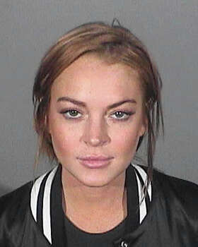 In this booking photo provided by the Santa Monica Police Department, actress Lindsay Lohan is seen at the Santa Monica Police Station on March 19, 2013 in Santa Monica, California. Lindsay was ordered to turn herself in for booking after pleading no contest to the charge of reckless driving, providing false information to an officer and willfully resisting, obstructing or delaying an officer.  (Photo by  Santa Monica Police Department via WireImage) Photo: Handout / 2013 Santa Monica Police Department