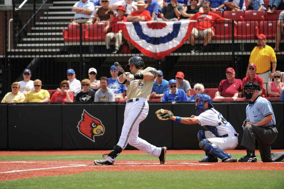 Vanderbilt's Curt Casali connects for a hit during an NCAA tournament game. After a solid season at frist base and DH, the New Canaan native is playing in the Cape Cod league with hopes of returning catching. Photo: Contributed Photo, ST / Stamford Advocate Contributed