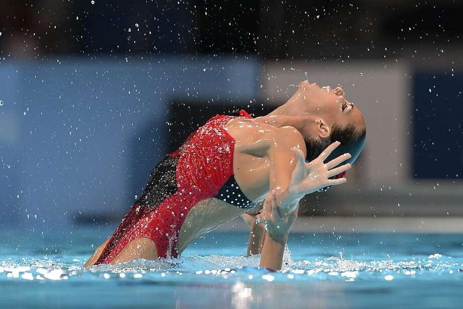 Duel in the pool:Synchronized swimmer Ona Carbonell Ballestero gets a lift from partner Margalida Crespi 