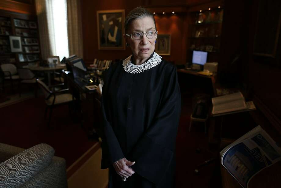 Associate Justice Ruth Bader Ginsburg poses for a photo in her chambers at the Supreme Court in Washington, Wednesday, July 24, 2013, before an interview with the Associated Press. Ginsburg said during the interview that it was easy to foresee that Southern states would push ahead with tougher voter identification laws and other measures once the Supreme Court freed them from strict federal oversight of their elections.  (AP Photo/Charles Dharapak) Photo: Charles Dharapak, Associated Press