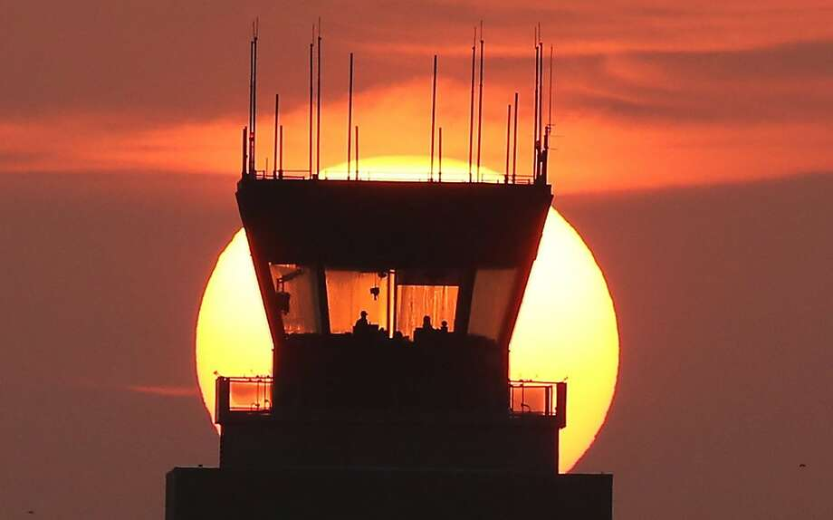An enormous sunrises behind the Orlando Executive Airport control tower in Orlando, Fla. Photo: Red Huber, McClatchy-Tribune News Service