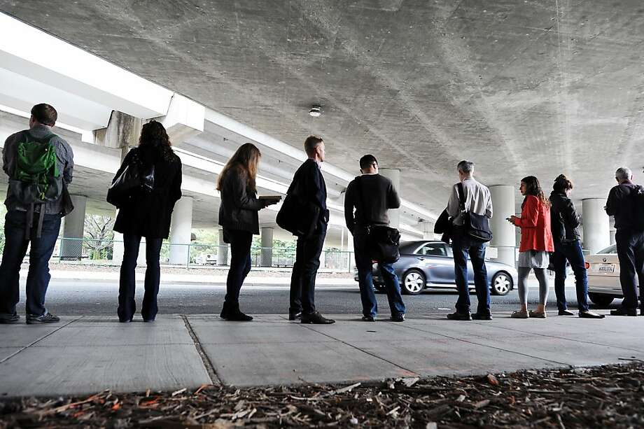 Casual carpoolers line up on Oakland's Hudson Street, in the option that worked best during the July strike. Photo: Michael Short 2013, Special To The Chronicle