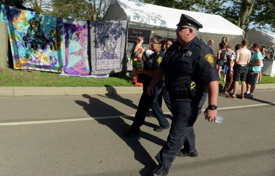 Bridgeport police officers patrol the 18th annual Gathering of the Vibes Musical Festival at Seaside Park in Bridgeport, Conn. Friday, July 26, 2013. Photo: Autumn Driscoll / Connecticut Post freelance