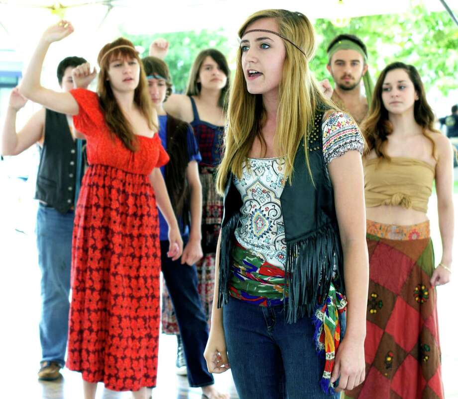 "Recent New Milford HIgh School graduate Erin Shaughnessy performs the role of Sheila, joined by castmates from TheatreWorks Stage Two's production of ""Hair,"" including Morgon Tracy,17, Andrew Taylor, 16,  Michelle Bohin, 16, Jordan Fox, 14, Andrew McGuire, 17, and Briyya Caceres, 17, during the Greater New Milford Chamber of Commerce's 46th annual Village Fair Days. July 26, 2013. The teens will present ""Hair"" in Aug. 9 and 10 performances at TheatreWorks. Photo: Trish Haldin"