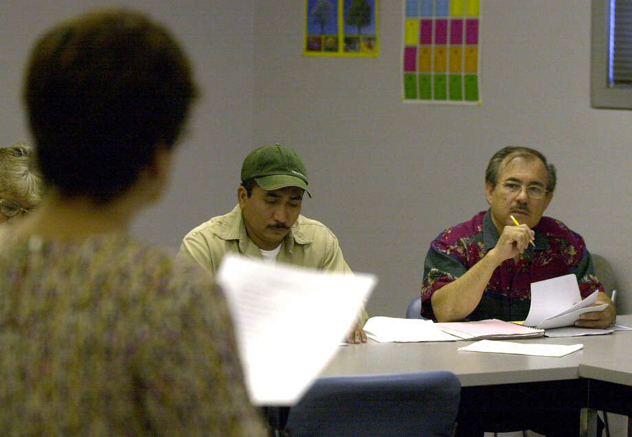 Immigrants take classes at the Margarita R. Huantes Learning and Leadership Development Center to improve their chances of acquiring U.S. citizenship. The facility should remain open on Saturdays. Photo: John Davenport, San Antonio Express-News
