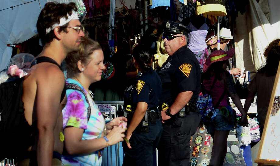 Bridgeport police officers watch foot traffic during their patrol at the 18th Annual Gathering of the Vibes music festival at Seaside Park in Bridgeport, Conn. on Friday July 26, 2013. Photo: Christian Abraham / Connecticut Post freelance