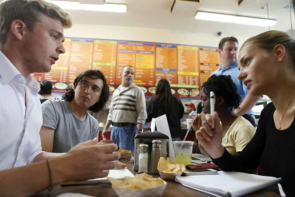 Students at Draper University, a boarding school for wanna-be entrepreneurs, have a business meeting to discuss plans for a start-up over their lunch break in San Mateo, Calif. on July 23, 2013.