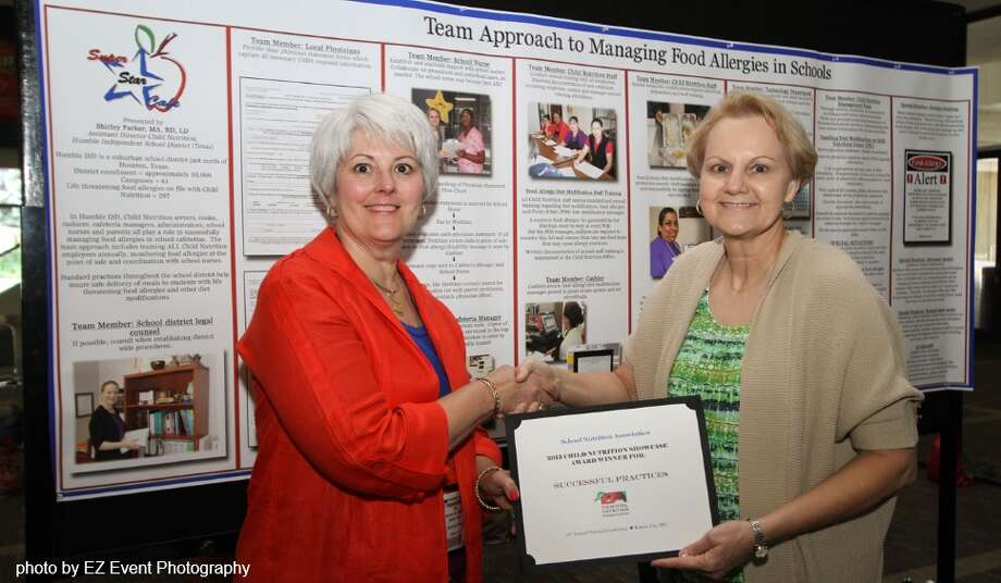 ShirleyParker, right, of Humble Independent School District, receives a certificate of recognition from Beth Rice, of Murray State University in Kentucky. Photo: Provided By Humble Independent School District