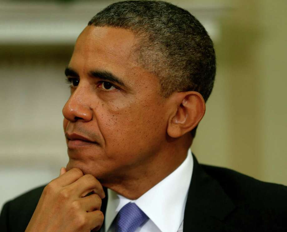 President Barack Obama may feel like consulting with predecessor George W. Bush right about now as he copes with the pressure of deciding to pursue military action in Syria. Photo: Charles Dharapak, Associated Press / AP