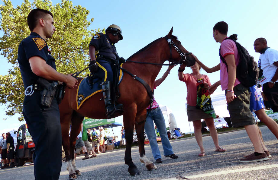 Bridgeport mounted officer Herbie Mack and his horse Boots on patrol at the 18th Annual Gathering of the Vibes music festival at Seaside Park in Bridgeport, Conn. on Friday July 26, 2013. At left is officer Ilidio Pereira. Photo: Christian Abraham / Connecticut Post freelance