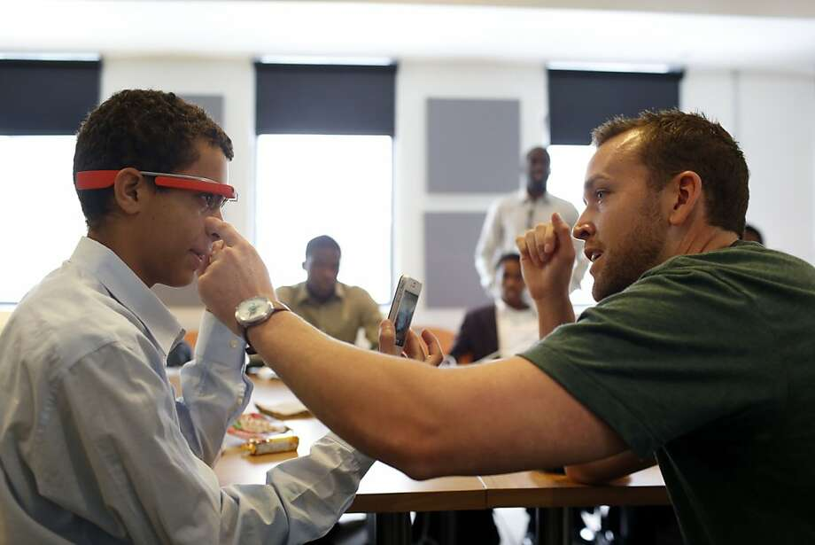 Matthew Wardenaar of Tagged (right) gives Mohammed Abdulla a hand with Google Glass during a session of the Hidden Genius Project, formed by technology professionals, nonprofits and educators to give underrepresented minorities guidance in moving toward STEM education and the tech sector. Photo: Ian C. Bates, The Chronicle