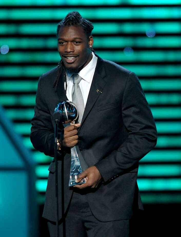 "Jadeveon Clowney accepts the 2013 ESPY Award for best play - for a clean hit that could now get him tossed for ""targeting."" Photo: John Shearer, Associated Press"