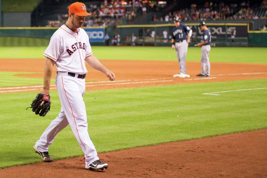 Astros starting pitcher Erik Bedard leaves the game during the seventh inning after giving up two runs, but no hits, against the Seattle Mariners at Minute Maid Park on Saturday, July 20, 2013, in Houston. ( Smiley N. Pool / Houston Chronicle ) Photo: Smiley N. Pool / © 2013  Smiley N. Pool