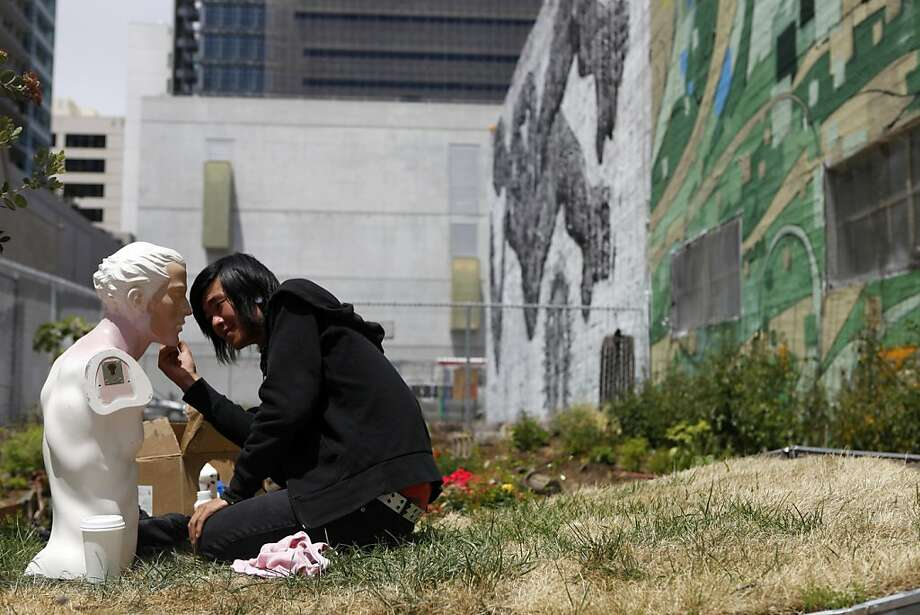 Ken Li paints a bust in the garden area at Freespace, a temporary community center open for two months in a warehouse in San Francisco's Mid-Market neighborhood. The experimental space will seek a new home. Photo: Katie Meek, The Chronicle