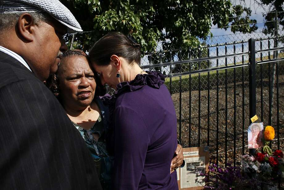 The Rev. Greggory Brown, Barbara Taylor and Oakland Councilwoman Libby Schaaf comfort each other at a gathering to speak out against violence. Photo: Lacy Atkins, The Chronicle