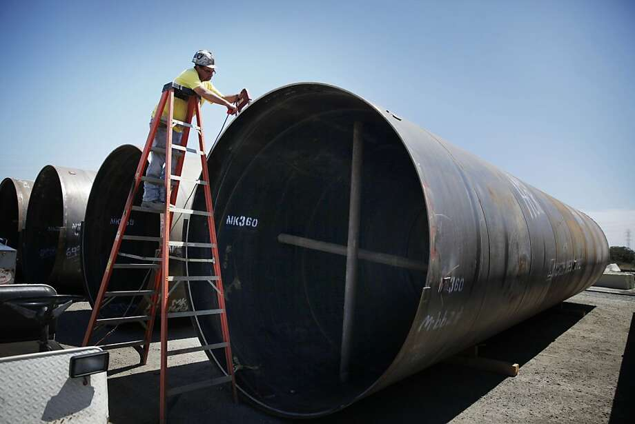 Noah Martin of Apex Testing checks steel pipe that will carry water through a tunnel between Newark and Menlo Park. Photo: Lea Suzuki, The Chronicle