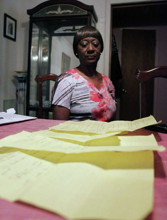 Gloria Lilly sits in front of the pages of notes from communicating with the City of Houston water department Wednesday, July 24, 2013, in Houston. The city water lines in Lilly's neighborhood have had multiple breaks and service interruptions in addition to flooding under her home from the leaks. Photo: James Nielsen, Houston Chronicle / © 2013  Houston Chronicle