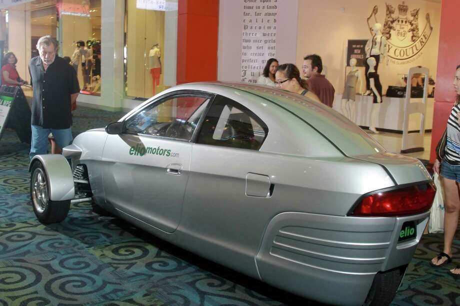 The Elio draws attention at Katy Mills. It has a three-cylinder engine, will cost $6,800 - if it ever goes into production - and will come with three air bags and antilock brakes. Photo: Gary Fountain, Freelance / Copyright 2013 Gary Fountain