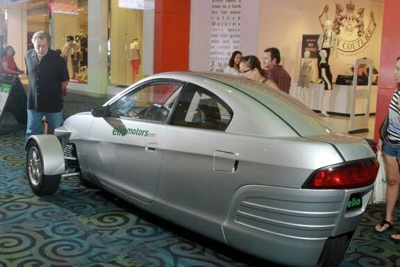 The Elio draws attention at Katy Mills. It has a three-cylinder engine, will cost $6,800 - if it ever goes into production - and will come with three air bags and antilock brakes.