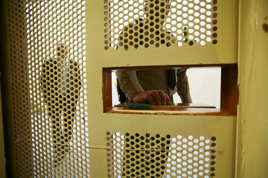 FILE -- A prison guard outside a solitary confinement cell at Pelican Bay State Prison in Crescent City, Calif., Feb. 9, 2012. Widespread participation in a 2013 hunger strike over solitary confinement has been linked to anger over California's record in addressing poor conditions and overcrowding. (Jim Wilson/The New York Times) Photo: Jim Wilson, New York Times
