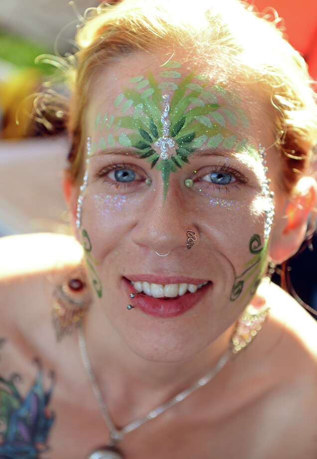 Colette Tomolonis, of Bradleboro, VT, proudly displays her face painting done by Ali Chambliss at 18th Annual Gathering of the Vibes music festival at Seaside Park in Bridgeport, Conn. on Friday July 26, 2013. Photo: Christian Abraham / Connecticut Post freelance