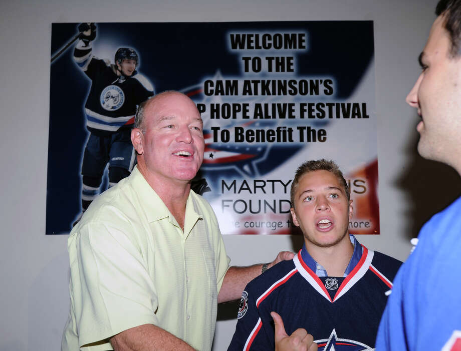At left, former N.Y. Jet football star Marty Lyons shakes hands with New York Ranger Derick Brassard, right, as Greenwich native, Cam Atkinson, center, of the Columbus Blue Jackets, smiles during the Cam Atkinson Keep Hope Alive Festival to benefit the Marty Lyons Foundation at Old Town Hall in Stamford, Friday night, July 26, 2013. The Marty Lyons FoundationâÄôs mission is granting wishes to children with terminally ill and life threatening illnesses Photo: Bob Luckey / Greenwich Time