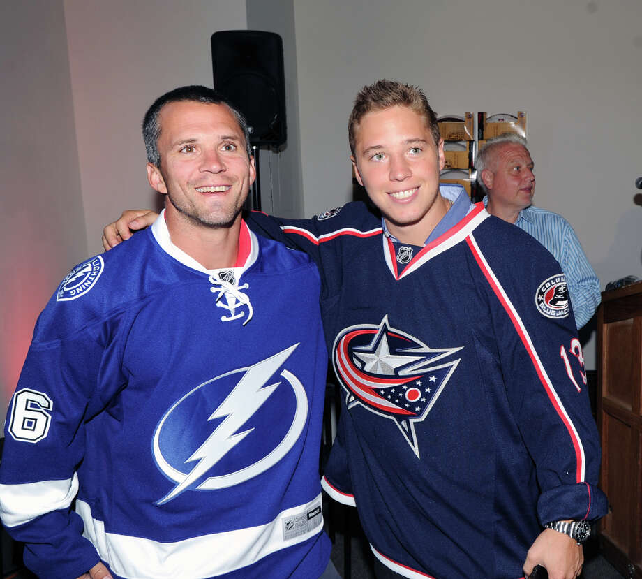 At left, Greenwich resident, Martin St. Louis of the NHL's Tampa Bay Lightning with Greenwich native, Cam Atkinson of the Columbus Blue Jackets, during Atkinson's Keep Hope Alive Festival to benefit the Marty Lyons Foundation at Old Town Hall in Stamford, Friday night, July 26, 2013. The Marty Lyons FoundationâÄôs mission is granting wishes to children with terminally ill and life threatening illnesses. Photo: Bob Luckey / Greenwich Time