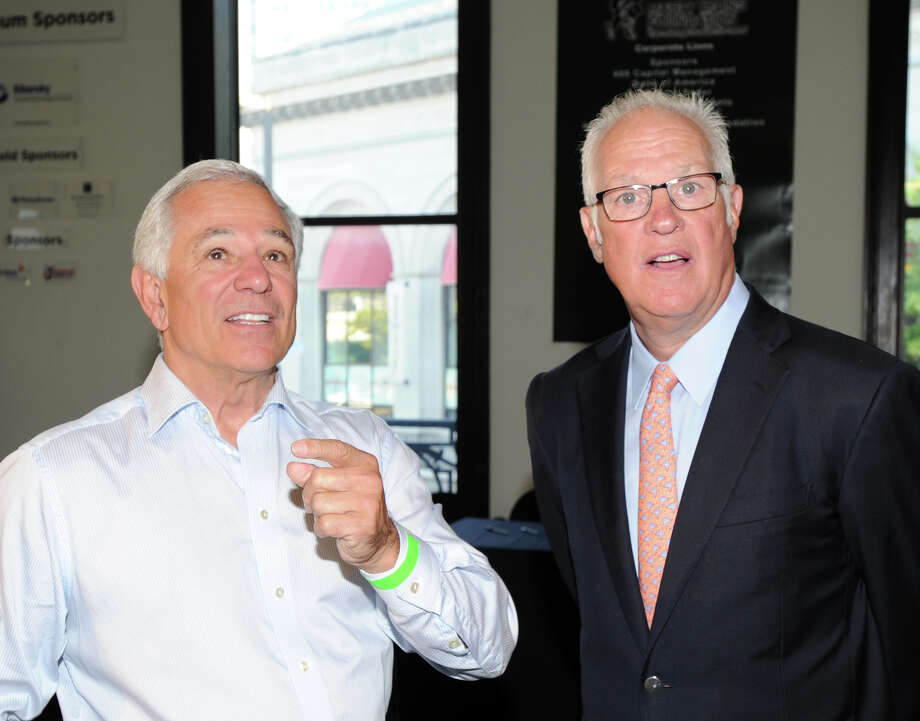 Stamford sports legend, Bobby Valentine, left, speaks with former N.Y. Ranger, Dave Maloney, during the Cam Atkinson Keep Hope Alive Festival to benefit the Marty Lyons Foundation at Old Town Hall in Stamford, Friday night, July 26, 2013. Photo: Bob Luckey / Greenwich Time